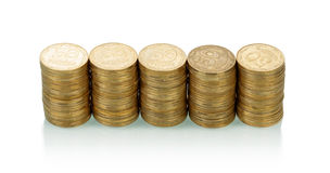 Pile delle monete su bianco Fotografia Stock Libera da Diritti