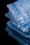 Pile of denim jeans Royalty Free Stock Image