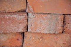 Pile des briques rouges closeup Photographie stock libre de droits