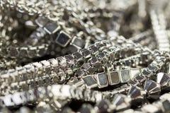 Pile des chaînes argentées assorties Photo stock