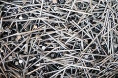 Pile des clous en acier Photographie stock libre de droits