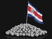 Pile des football du football et de drapeau de Costa Rican Photo stock