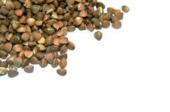 Pile des graines de sarrasin d'isolement au-dessus du fond blanc Photo libre de droits
