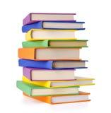 Pile des livres d'isolement sur le blanc Image libre de droits