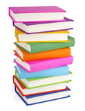 Pile des livres d'isolement sur le blanc Image stock