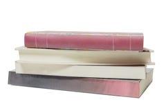Pile des livres d'isolement sur le blanc Images stock