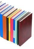 Pile des livres neufs sur le blanc Images libres de droits