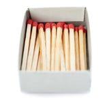 Pile des matchs en bois d'isolement au-dessus du fond blanc Photographie stock