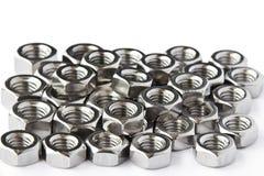 Pile des noix d'acier inoxydable Photos stock