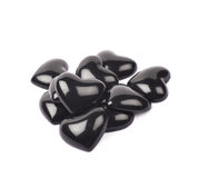Pile des perles en forme de coeur d'isolement Images libres de droits