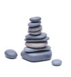 Pile des pierres d'isolement sur le fond blanc Image stock
