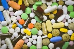 Pile des pilules et des capsules Photos libres de droits