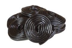 Pile des spirales noires de réglisse Images stock