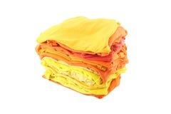Pile des tissus jaunes et oranges d'ombre Image libre de droits