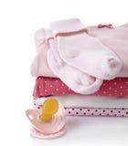 Pile des vêtements roses de bébé photo stock