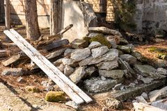 Pile of destroyed and demolished concrete wall.Wood and broken concrete on the pile. royalty free stock photography