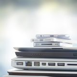 Pile of devices. Pile of electronical devices on gray bakcground - technology concept royalty free stock images