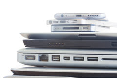 Pile of devices. Pile of electronical devices on white - technology concept stock photo