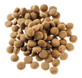 Isolated Dog Food - Top View. Pile of dey dog food isolated on white background, seen from directly above Royalty Free Stock Image