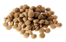 Isolated Dog Food Pile. Pile of dey dog food isolated on white background, from a slightly high angle Stock Image