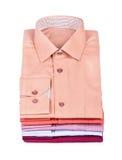 Pile di molti vestiti colorati Fotografie Stock Libere da Diritti