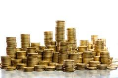 Pile di monete Immagini Stock