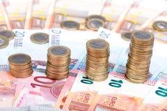 Pile di monete che aumentano di dimensione Immagine Stock Libera da Diritti
