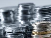 Pile di monete dei soldi Fotografia Stock
