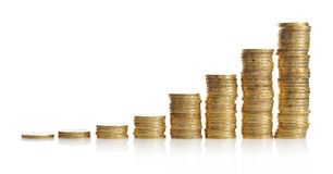 Pile di monete di oro Immagine Stock
