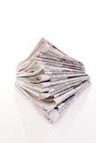 Pile di vecchi giornali e scomparti Immagine Stock
