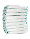 Pile of 9 diapers on white background Stock Images