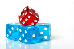 Pile of Dice. Stack of red and blue dice on a white background stock photos