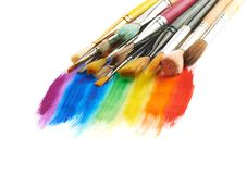 Pile of different brushes over the paint strokes Stock Image