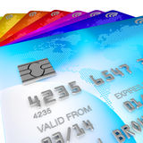 Pile of different coloured orignal designe, credit cards. Brightly coloured, blue, red, orange, yellow, pink and purple and green 3d renders of credits cards Royalty Free Stock Photos