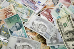 Pile of different currencies Stock Photo