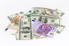 Pile of different currencies isolated on white background Stock Image