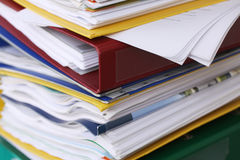 Pile of different file folders or ring binders full with office documents and paper work Stock Photo
