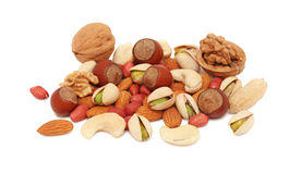 Pile from different nuts on white background Royalty Free Stock Photos