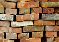 Pile of different old bricks stock photos