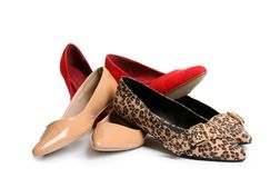 Pile of different shoes. On white background royalty free stock image