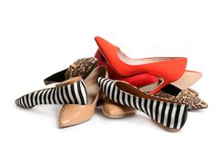 Pile of different shoes. On white background royalty free stock photos