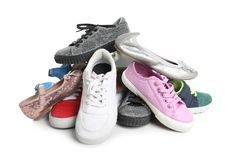 Pile of different shoes. On white background royalty free stock photo