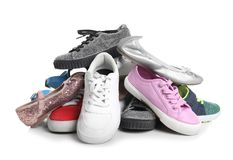 Pile of different shoes on white. Background royalty free stock images