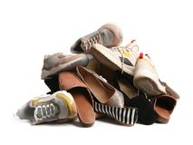 Pile of different shoes on white. Background royalty free stock photos