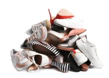 Pile of different shoes on white. Background stock photo