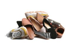 Pile of different shoes on white. Background royalty free stock photography