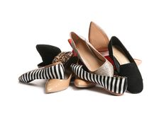 Pile of different shoes. On white background stock photos