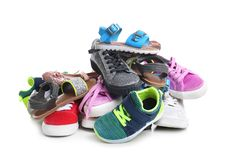 Pile of different shoes. On white background stock photography