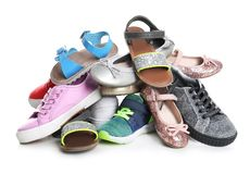 Pile of different shoes on white. Background stock photos