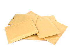 Pile different size bubble lined shipping or packing envelopes Royalty Free Stock Photos